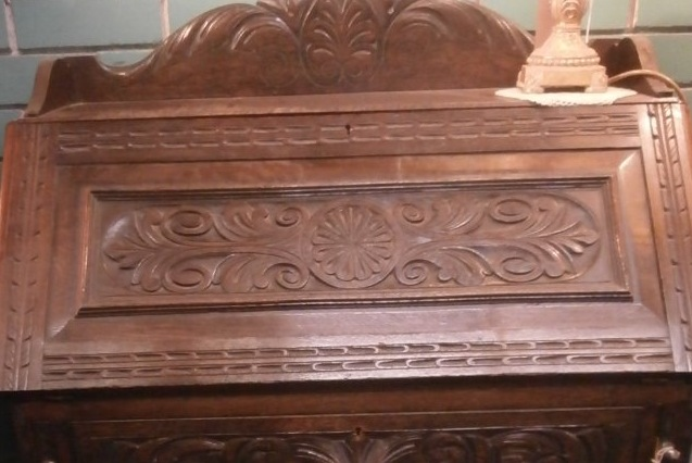 Beautiful carvings in this bureau